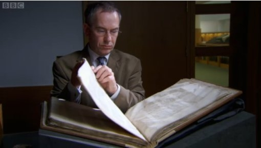 Scott McKendrick of the British Library with Codex Sinaiticus